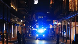 Members of the New Orleans Police Department help clear Bourbon Street on March 16, 2020.