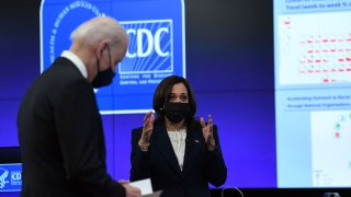US Vice President Kamala Harris, with President Joe Biden (L), speaks to staff as she tours the Centers for Disease Control and Prevention in Atlanta, Georgia, on March 19, 2021.