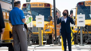 US Vice President Kamala Harris speaks as she tours the Thomas Built Buses factory in High Point, North Carolina, April 19, 2021