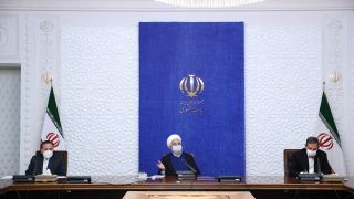 Iranian President Hassan Rouhani (C) makes a speech on Iran's foreign policy and economic crisis as he gathers with economists in Tehran, Iran on April 26, 2021.