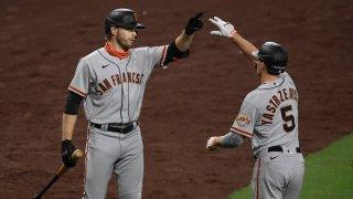 Mike Yastrzemski of the San Francisco Giants is congratulated by Austin Slater.