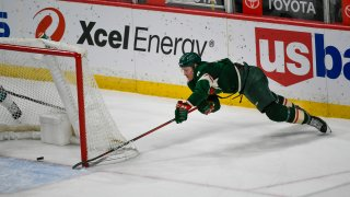 Minnesota Wild center Nico Sturmmakes a wraparound shot for goal against the San Jose Sharks during the second period of an NHL hockey game Saturday, April 17, 2021, in St. Paul, Minnesota.