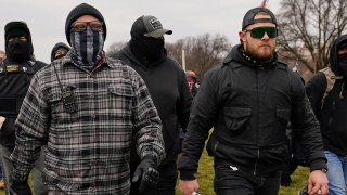 In this Jan. 6, 2021, file photo, Proud Boys members Joseph Biggs, left, and Ethan Nordean, right, walk toward the U.S. Capitol in Washington.