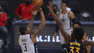 Washington Wizards forward Bradley Beal, left, shoots against Golden State Warriors center James Wiseman during the first half of an NBA basketball game in San Francisco, Friday, April 9, 2021.