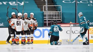 The Anaheim Ducks celebrate after scoring against the San Jose Sharks.