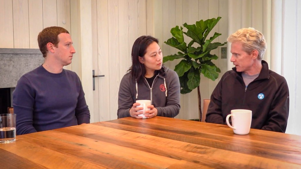 Mark Zuckerberg and Priscilla Chan sit at their dining room table with biophysicist Joe DeRisi