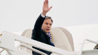 Secretary of State Antony Blinken waves as he departs Andrews Air Force Base, Maryland on May 24, 2021.