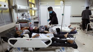 Afghan school students are treated at a hospital after a bomb explosion near a school in west Kabul