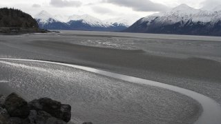 FILE - In this March 7, 2016, file photo, a ribbon of water cuts through the mud flats of Cook Inlet, just off the shore of Anchorage, Alaska. The Trump administration on Thursday, Jan. 4, 2018 moved to vastly expand offshore drilling from the Atlantic to the Arctic oceans with a plan that would open up federal waters off the Pacific coast for the first time in more than three decades. Cook Inlet is one of those areas.