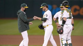Manager Bob Melvin #6 of the Oakland Athletics takes the ball from pitcher Cole Irvin #19