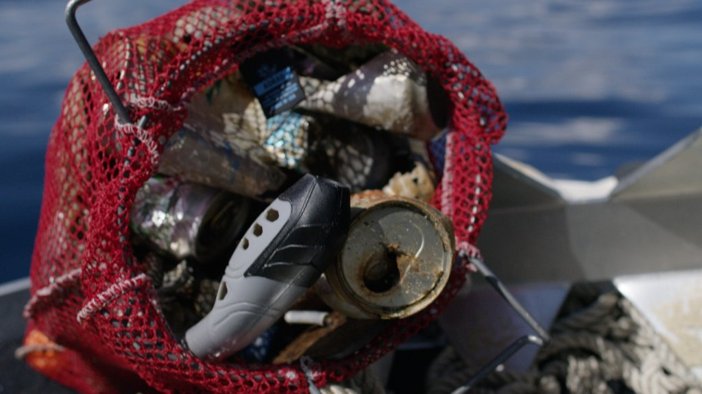 A mesh bag filled with trash and other debris found in Lake Tahoe.