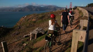 Visitors along the California Coastal Trail above the Golden Gate Bridge in San Francisco.