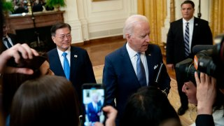 U.S. President Joe Biden, right, and Moon Jae-in, South Korea's president, depart from a news conference in the East Room of the White House in Washington, D.C., U.S., on Friday, May 21, 2021.