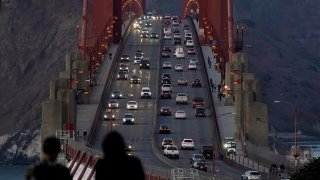 In this Nov. 12, 2020, file photo, traffic moves on the Golden Gate Bridge in San Francisco. The San Francisco Chronicle reported Saturday, May 15, 2021, that the iconic span started emanating a loud hum following a retrofit last year of the sidewalk safety railing on its western side. Crews replaced some 12,000 wide slats with narrower ones, to give the bridge a slimmer profile and make it safer in high winds.