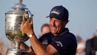 Phil Mickelson holds the Wanamaker Trophy after winning the PGA Championship golf tournament on the Ocean Course, Sunday, May 23, 2021, in Kiawah Island, South Carolina.