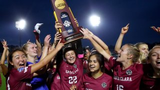 The Santa Clara Broncos celebrate with the trophy after their win against the Florida State Seminoles during the Division I Women's Soccer Championship.