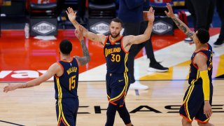 Mychal Mulder, Stephen Curry and Juan Toscano-Anderson of the Golden State Warriors celebrate.