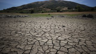 Dry cracked earth is visible as water levels are low at Nicasio Reservoir on May 28, 2021 in Nicasio, California.