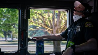 Salem Fire Department paramedic Justin Jones tries to stay cool after responding to a heat exposure call during a heat wave