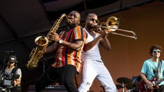 Trombone Shorty, center right, of Trombone Shorty & Orleans Avenue, performs at the New Orleans Jazz and Heritage Festival on Sunday, May 5, 2019, in New Orleans.