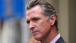 In this June 3, 2021 file photo, California Gov. Gavin Newsom listens to questions during a news conference outside a restaurant in San Francisco. Six weeks after California officials announced that Newsom would face an almost certain recall election, the contest remains framed by uncertainty even the date when it might take place is unclear.