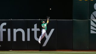 Ramon Laureano #22 of the Oakland Athletics catches a fly ball.