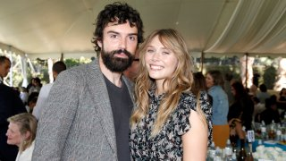 BEVERLY HILLS, CALIFORNIA - OCTOBER 06: (L-R) Robbie Arnett and Elizabeth Olsen attend the Rape Foundation Annual Brunch 2019 at a Beverly Hills Private Estate on October 06, 2019 in Beverly Hills, California.