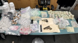 Guns, drugs and cash seized in Oakland.