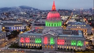 San Francisco City Hall is lit up in the red, green and black colors of the pan-African flag to commemorate Juneteenth on Friday, June 19, 2020, in San Francisco, Calif. as part of ongoing Black Lives Matter protests across the country in the wake of the death of George Floyd.