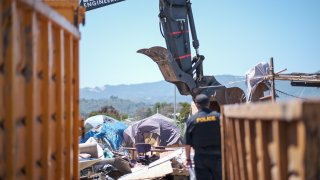 A homeless encampment in Sausalito is cleared.