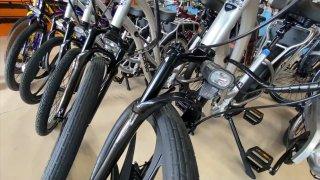 A row of e-bikes in a San Diego shop.