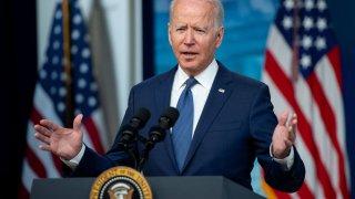 U.S. President Joe Biden speaks at a podium