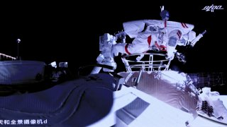 Liu Boming stepping out of core module of the China's new space station in space