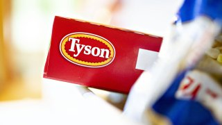 The Tyson Foods Inc. logo is seen on a box arranged for a photograph in Tiskilwa, Illinois, U.S., on Monday, Aug. 6, 2018. The largest U.S. meat company posted better-than-expected fiscal third-quarter earnings as beef demand rose and cattle costs fell, Tyson said Monday in astatement.