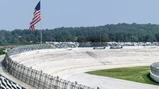 This file image shows a general view of an empty race track and American flag.