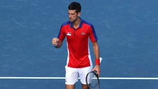 Novak Djokovic competes in Tokyo