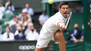 Novak Djokovic competes at Wimbledon