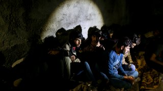 Afghan migrants apprehended by Turkish security forces