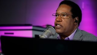 FILE — In this July 12, 2021 file photo radio talk show host Larry Elder speaks during his show, in Burbank, Calif.