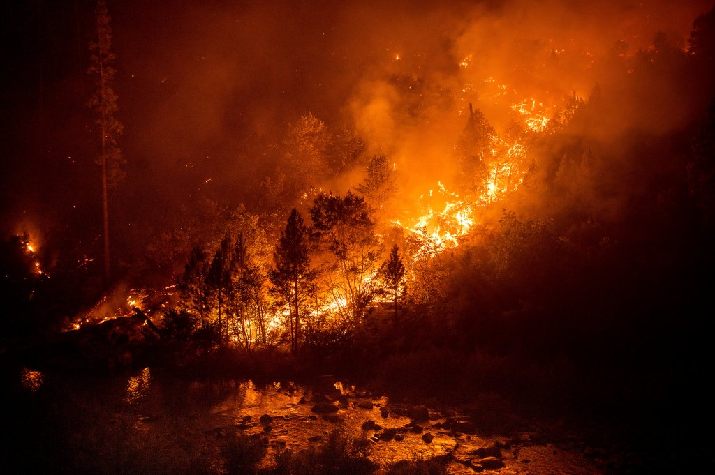 The Caldor Fire burns above the South Fork of the American River in the White Hall community of El Dorado County, Calif., on Friday, Aug. 27, 2021.