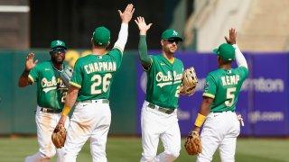 Oakland Athletics players Starling Marte #2, Matt Chapman #26, Stephen Piscotty #25 and Tony Kemp #5 celebrate.