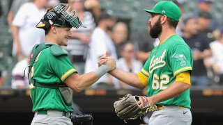 Sean Murphy #12 and Lou Trivino #62 of the Oakland Athletics celebrate