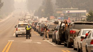 Residents are stuck in gridlock while attempting to evacuate as the Caldor fire approaches in South Lake Tahoe.
