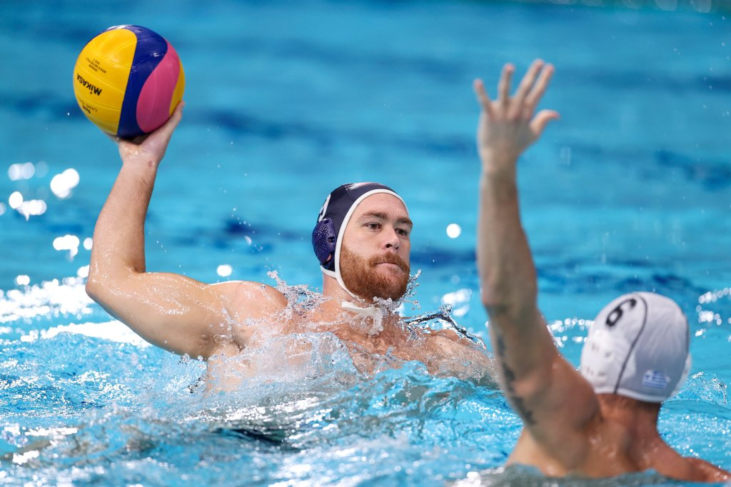 Alex Bowen of Team United States is blocked by Alexandros Papanastasiou of Team Greece during the Men's Preliminary Round Group A match between Greece and the United States on day ten of the Tokyo 2020 Olympic Games at Tatsumi Water Polo Centre on Aug. 2, 2021, in Tokyo, Japan.