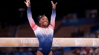 Simone Biles competes on beam