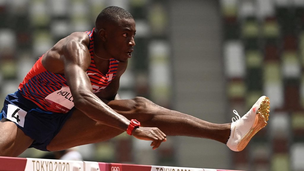 USA's Grant Holloway competes in the men's 110m hurdles semi-finals during the Tokyo 2020 Olympic Games