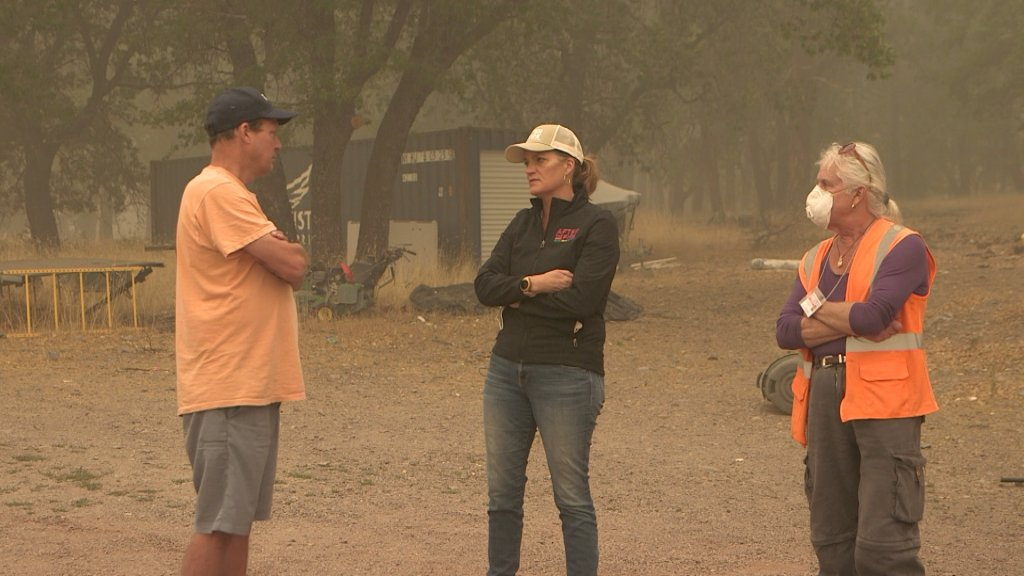 Jennifer Gray Thompson of After the Fire meets with Plumas County Supervisor Kevin Goss, left, and Greenville business owner Ken Donnell.