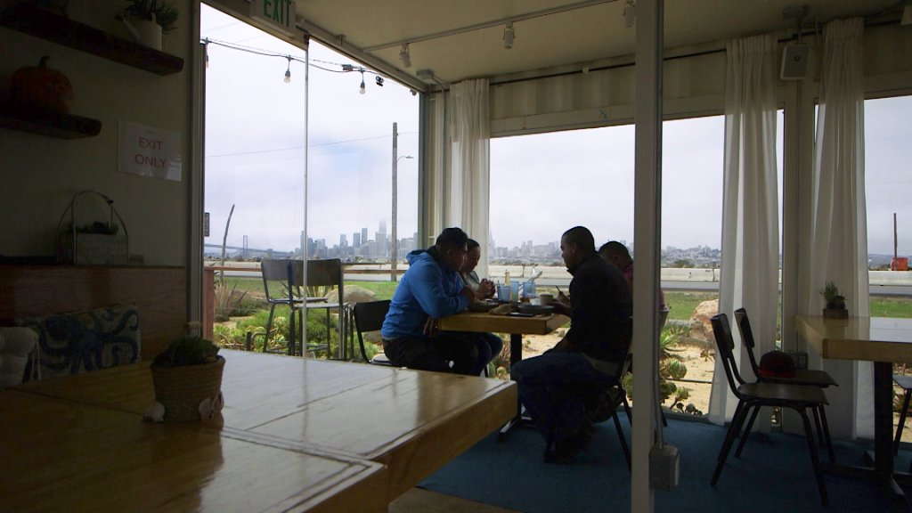 Workers at Mersea Restaurant eat lunch with a view of San Francisco.