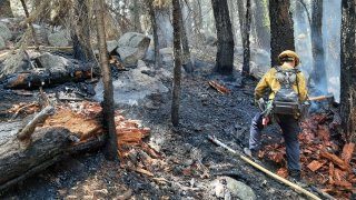A firefighter works at the scene of a wildfire near Lake Tahoe.
