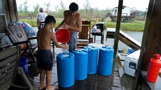 barrels of rainwater they collected from Tropical Storm Nicholas